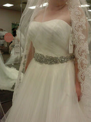 David's Bridal 'Strapless' size 14 new wedding dress front view on bride