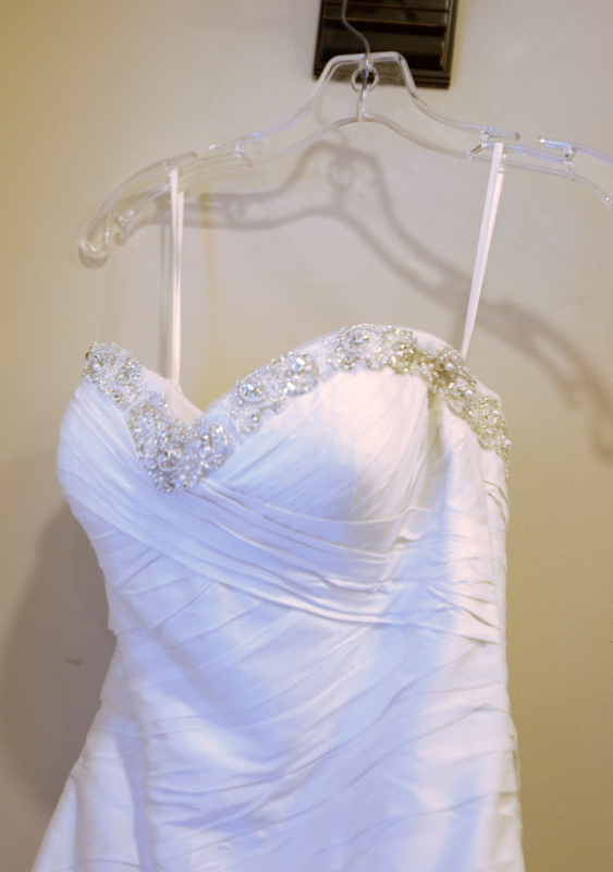 Justin Alexander '8506' size 4 used wedding dress front view close up on hanger