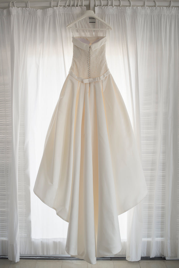 Pronovias 'Barcli' size 6 used wedding dress back view on hanger