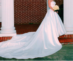 Audrey Hart 'Italian Satin' size 6 used wedding dress side view on bride
