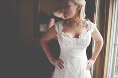 Romona Keveza 'L5106' size 6 used wedding dress front view close up on bride