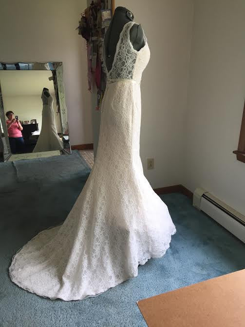 Custom 'Madeline' size 6 used wedding dress side view on mannequin