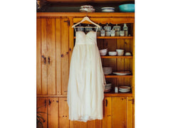 Sarah Seven 'Practically Perfect' size 4 used wedding dress front view on hanger