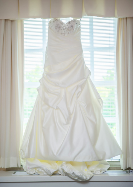 Maggie Sottero 'Parisianna' size 8 used wedding dress front view on hanger