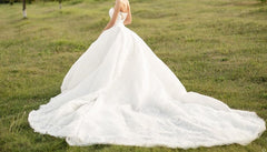 Jacy Kay 'Custom' size 6 used wedding dress back view on bride