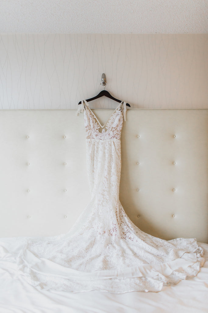Inbal Dror '13-05' size 6 used wedding dress back view on hanger