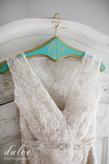 Monique Lhuillier 'Aurora' size 8 used wedding dress front view of bodice on hanger