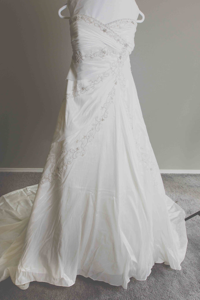 Custom 'Meagan Schlottmann'  size 16 used wedding dress front view on hanger