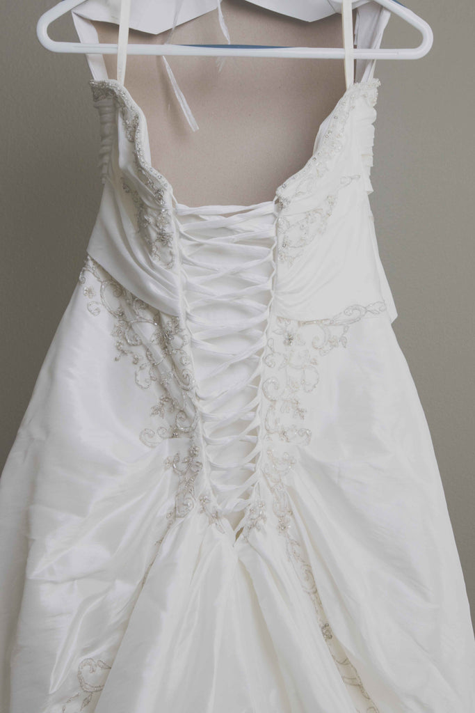 Custom 'Meagan Schlottmann'  size 16 used wedding dress back view close up  on hanger