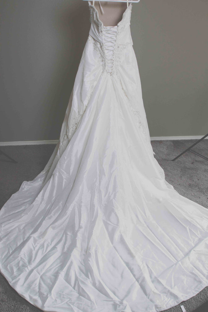 Custom 'Meagan Schlottmann'  size 16 used wedding dress back view on hanger