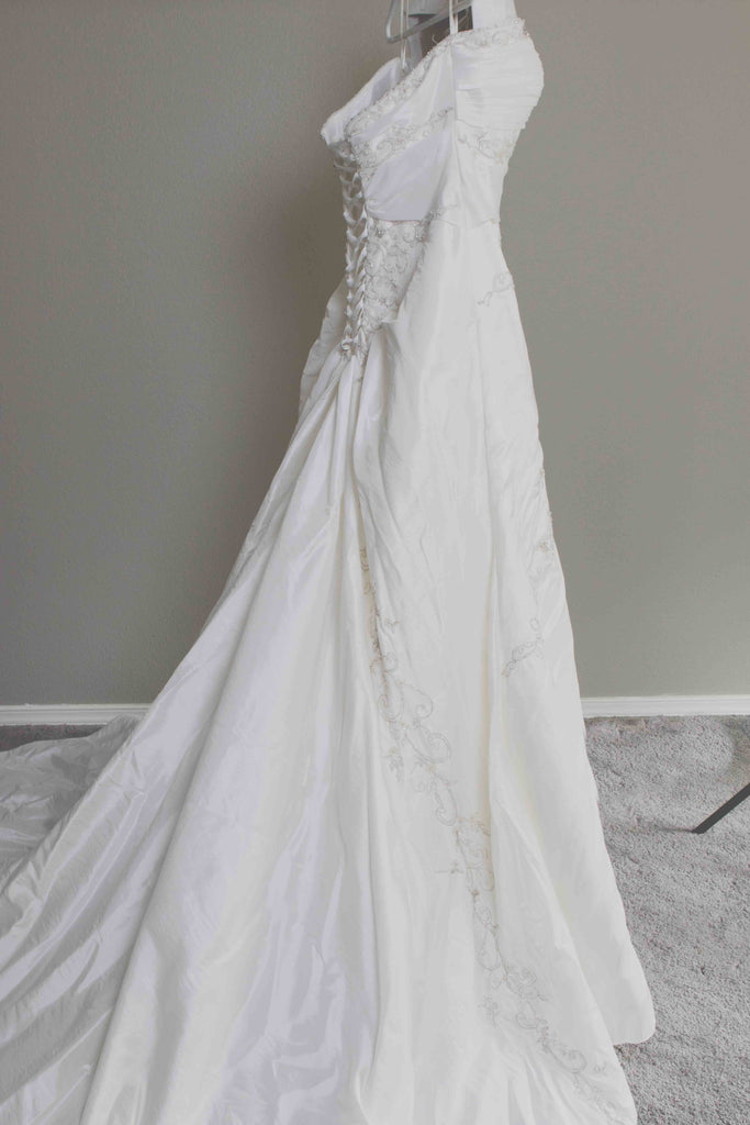 Custom 'Meagan Schlottmann'  size 16 used wedding dress side view on hanger