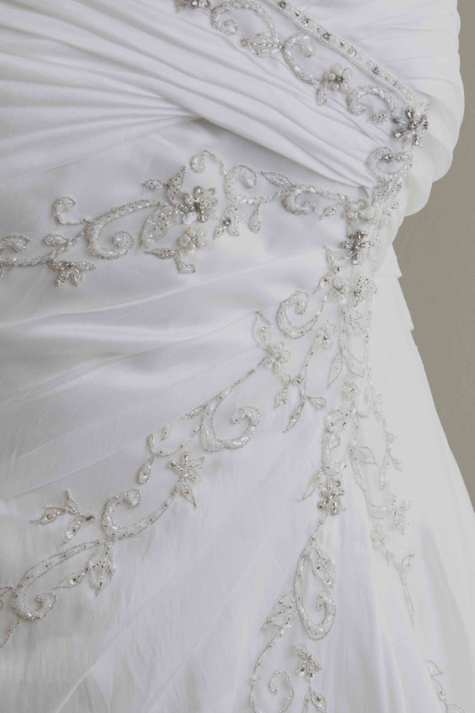 Custom 'Meagan Schlottmann'  size 16 used wedding dress close up of fabric