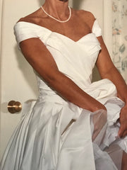 Christian Dior 'Silk Carmeuse' size 2 used wedding dress front view close up on bride
