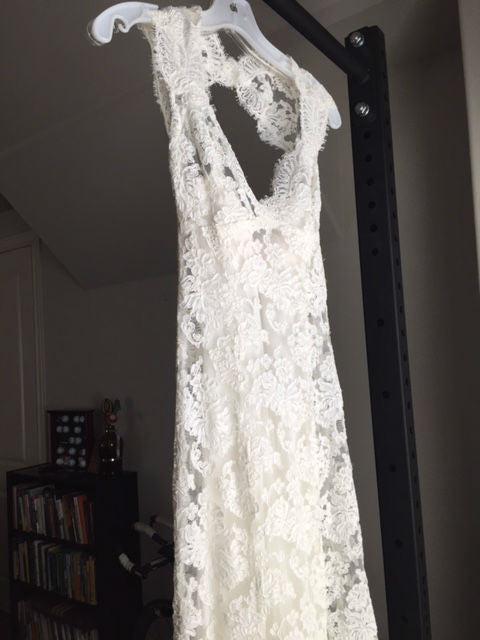 Monique Lhuillier 'Scarlet' size 2 used wedding dress front view on hanger