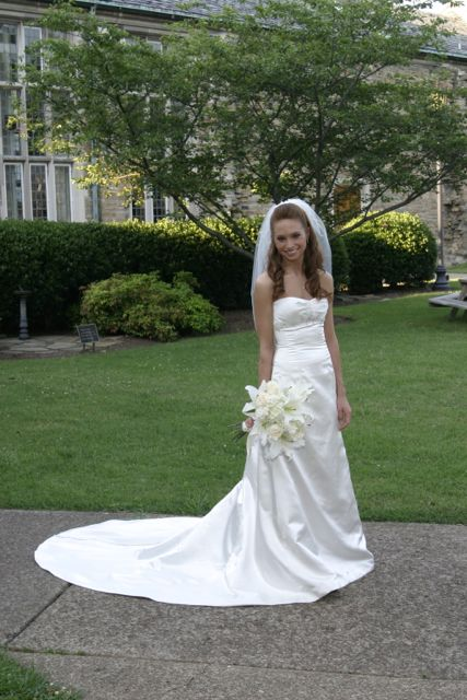 Rivini 'Etoile' size 2 used wedding dress front view on bride