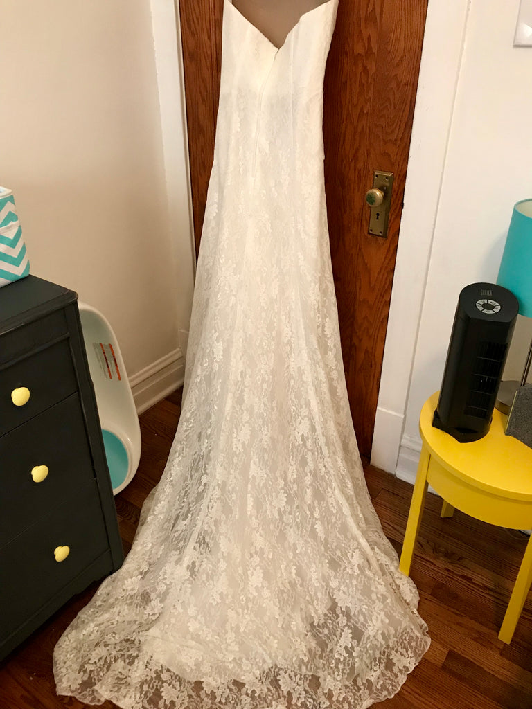 David's Bridal 'Lace Strapless' size 8 used wedding dress front view on bride