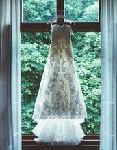 Load image into Gallery viewer, Enzoani 'Blue' size 4 used wedding dress front view on hanger