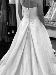 Cosmobella '7537' size 4 used wedding dress back view on bride