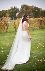 Olia Zavonzia 'Mel' size 8 used wedding dress side view on bride