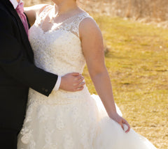 Custom 'Michala' size 16 used wedding dress front view close up on bride