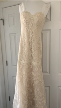 Load image into Gallery viewer, Essense of Australia 'Romantic Vintage Lace' size 8 used wedding dress front view on hanger