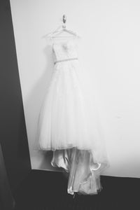 Sincerity 'Lacy' size 8 used wedding dress front view on hanger