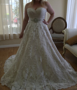 Maggie Sottero 'Kimaya' size 18 new wedding dress front view on bride