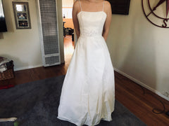 Paloma Blanca 'Blue Bird' size 8 used wedding dress front view on bride