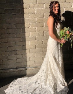 Rue De Seine 'Cosmic Coralee' size 6 used wedding dress side view on bride
