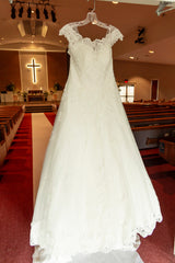 Maggie Sottero 'Kaitlyn' size 14 used wedding dress front view on hanger
