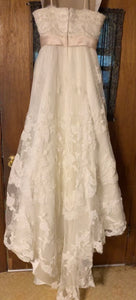 Casablanca '1900' size 10 used wedding dress back view on hanger
