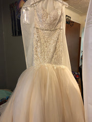 Maggie Sottero 'Lansing' size 10 used wedding dress front view on hanger