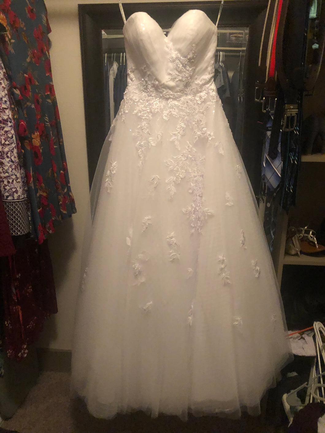 Mia Solano 'Phoenix' size 4 used wedding dress front view on hanger