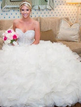 Load image into Gallery viewer, Lazaro 'Ivory Organza 3161' size 6 used wedding dress front view on bride