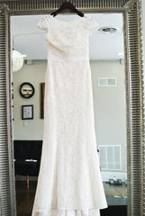 Amy Kuschel 'Babe' size 10 sample wedding dress front view on hanger