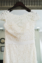 Load image into Gallery viewer, Amy Kuschel 'Babe' size 10 sample wedding dress back view on hanger