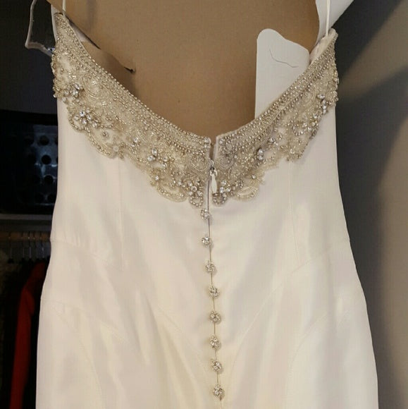 Victor Harper Couture '206' size 6 used wedding dress back view on hanger