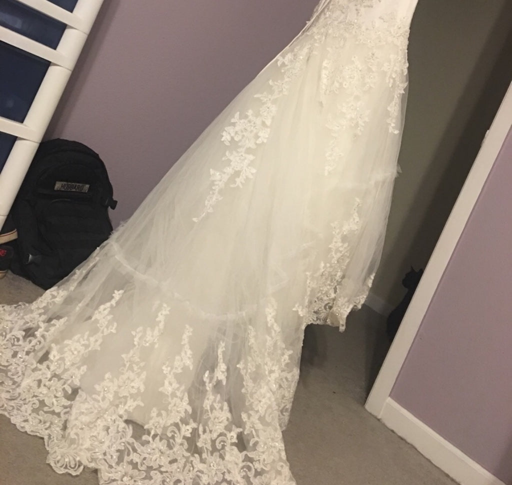 Cosmobella 'Milano' size 8 used wedding dress back view on hanger