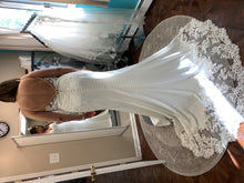 Load image into Gallery viewer, Stella York 'Sexy Beach' size 10 used wedding dress  back view on bride