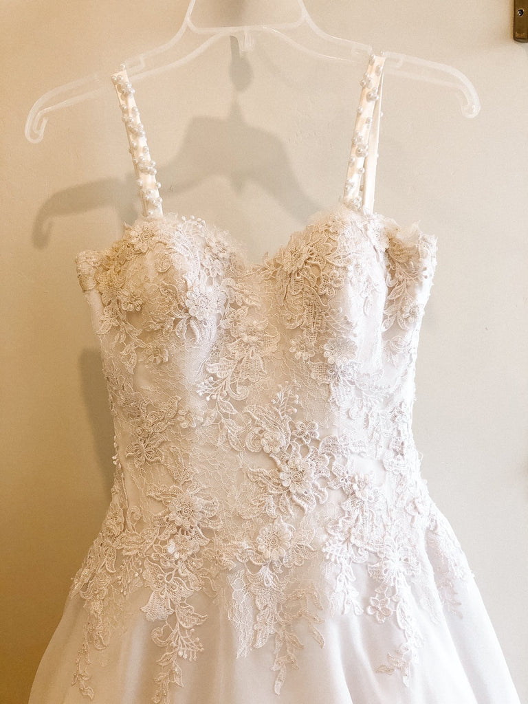 Pronovias 'Custom' size 2 used wedding dress front view on hanger