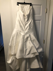 Augusta Jones 'Sweetheart Fit and Flare' size 16 used wedding dress back view on hanger