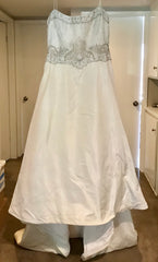 Style 3105 size 16 used wedding dress front view on hanger