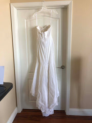 Rebecca Schoneveld 'Ines' size 2 used wedding dress back view on hanger