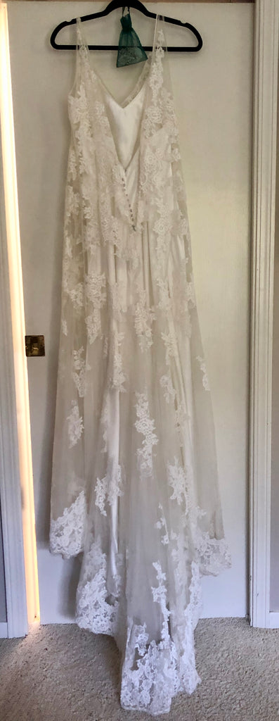 Maggie Sottero 'Trumpet Lace' size 14 sample wedding dress back view on hanger