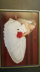 David's Bridal 'Michelangelo V8377' size 14 used wedding dress side view on bride