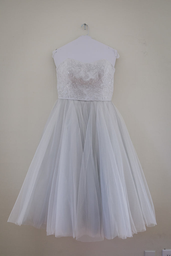 David's Bridal 'Tea Length' size 10 used wedding dress front view on hanger