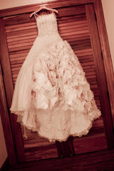Ysa Makino 'Beautiful Handmade Flowers' size 6 used wedding dress front view on hanger