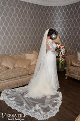 Galina Signature 'Lace Long Sleeve' size 12 used wedding dress side view on bride