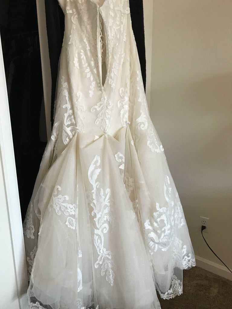 Sottero and Midgley 'Lovai' size 8 used wedding dress back view on hanger
