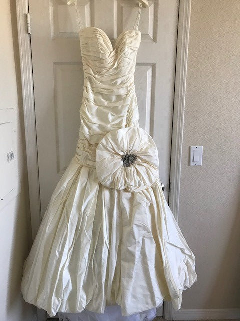 Ines Di Santo 'Turquoise' size 4 used wedding dress front view on hanger